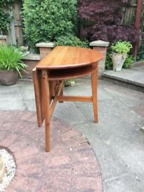 Semi circular drop leaf table