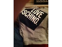 Moschino sweat shirt almost new not been worn much bargain