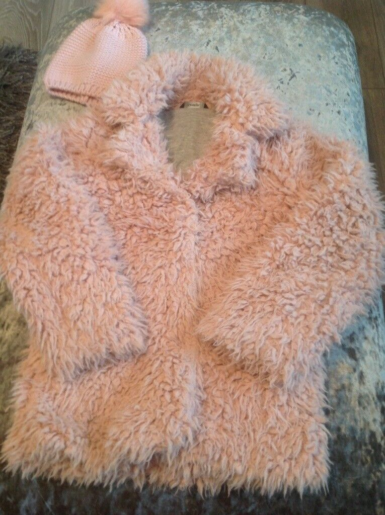 Girls pink fluffy jacket age 8/9 with matching bobble hat