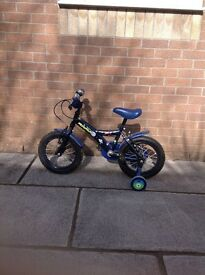 "Apollo Moonman, size 14"" child's bicycle with stabilisers."