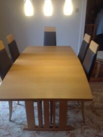 Solid oak dining table, matching chairs and side board