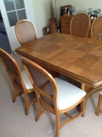 6 seater extending dining table and 6 chairs