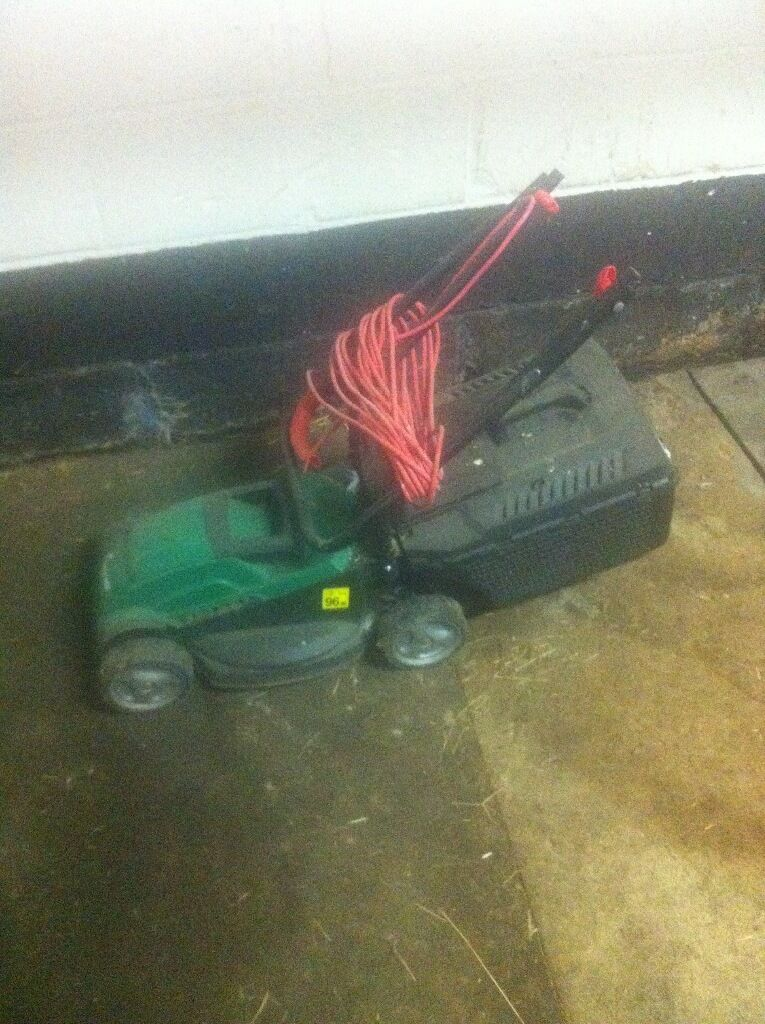 Electric lawn mower. Works fine