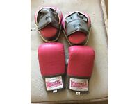 Pink boxing gloves with hook and jab pads