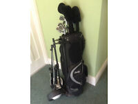 Full set of golf clubs, bag and trolley