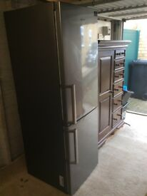 Silver/grey Samsung fridge freezer very good condition. House move forces sale.
