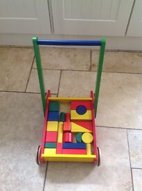 Colourful wooden baby walker with wooden shaped bricks