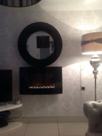 Living room set including mirror, fire place, ceiling light and black curtain pole