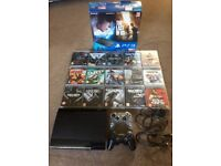PlayStation 3 super slim 500gb boxed in excellent condition with two controllers and 15 games
