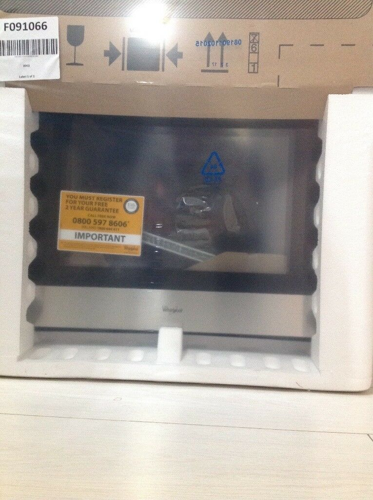 Still boxed Whirlpool electric oven.
