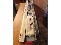 Knitting machine Toyota KS950 hardly used as new complete with table and instructions