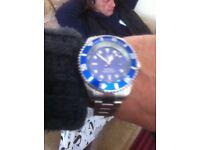 Blue face Rolex watch