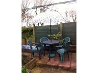 Garden table, 4 chairs & umbrella