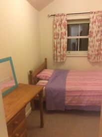 Double bed in lovely cottage