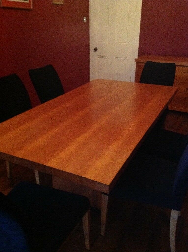 Cherry wood dining room table, and 6 black chairs