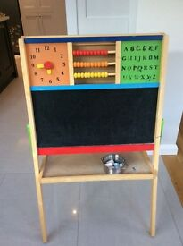 Black/white board easel with abacus alphabet and clock