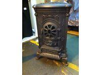 Cast iron wood burner lookalike mains gas fire
