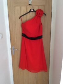 Red cocktail dress for sale size 14 with pretty flower detail on the shoulder