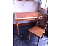 Compact kitchen wooden table unit with 4 wooden chairs; table has a tiled surface; good condition