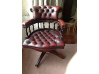 Dark red Leather captains swivel chair.