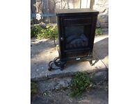 Electric coal effect heater with fan.