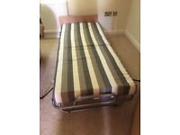 Folding single bed. Excellent condition as hardly used