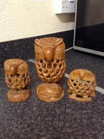 "Three wooden owl carvings with little owlets inside 6"", 4"" and 3"" in height £15"