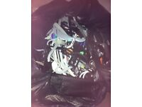 Black bag full of childrens plastic clothes hangers