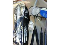 set of badminton rackets nets and shuttles