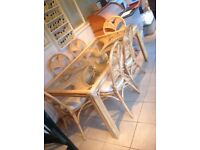Cane furniture dining set with two matching arm chairs and coffee side table