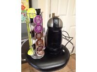 Dolce Gusto pod coffee machine with pods and holder