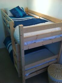 Beautiful pine bunk bed with 2 memory foam mattresses. Must be able to collect from storage unit