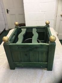 Green wooden Christmas tree stand with clamps