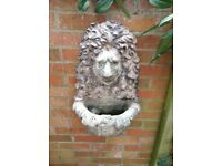 Stone lions head planter or water feature