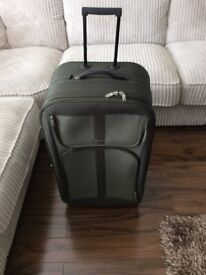Large green suitcase.