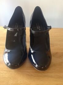 Patent (synthetic) black high heel by Carvela Kurt Geiger