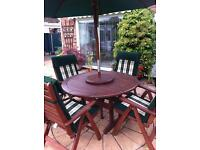 Table and 4 chairs & parasol