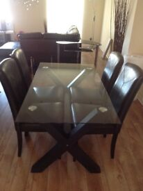 Glass Dinning Table with faux Leather Chairs