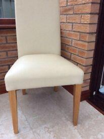 2 cream dining chairs