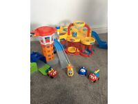 Bundle of 3 car plays.Vroom Planet, Fisher Price and Fisher Price garage tower. 4 Vehicles included