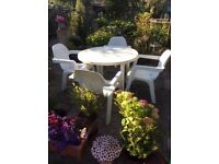 White garden extending table and 4 chairs