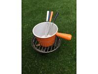 Retro orange crueset fondue set