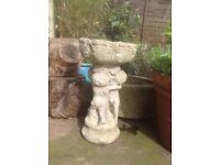 Stone look cast bird bath with cherubs. Good condition