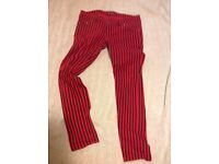 Black and red skinny jeans