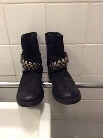 Brand new an worn Geox boots.