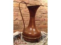 brass jug with copper trim