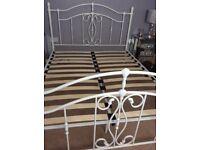 White metal king size bed