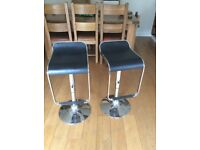 Two kitchen/bar stools. Adjustable height. Revolving seats.