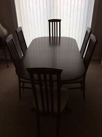 Rosewood dining table and six chairs