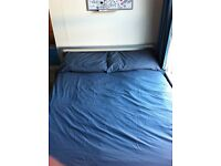 Silver coloured metal double bed and mattress